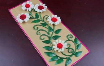 用舊紙板和塑料瓶制作花草裝飾畫