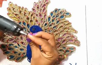 如何用麻繩DIY漂亮的孔雀掛件